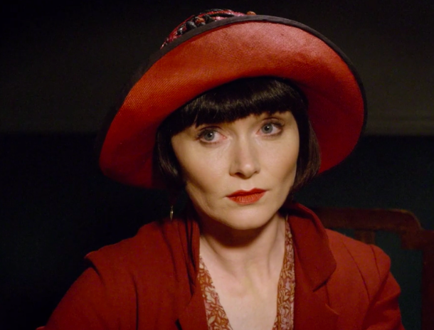 """Screenshotted picture from Season One - Episode 10, """"Death by Miss Adventure"""". Miss Phyrne Fisher looks very stern at her foe as she vows revenge."""