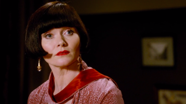 """Screenshotted picture from Season Two - Episode 11, """"Dead Air"""". Miss Phyrne Fisher at the helm of a radio mic for a bit of the talkies."""
